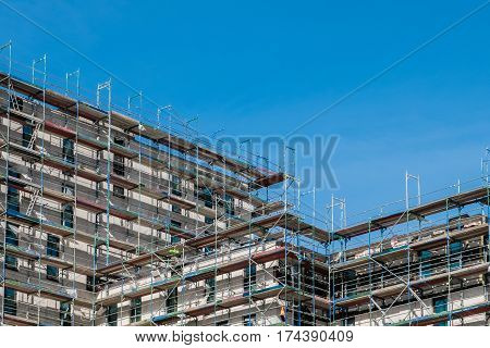 building construction site with scaffolding - building industry