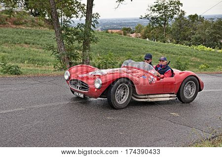 MELDOLA, FC, ITALY - SEPTEMBER 18: driver and co-driver on a vintage Italian car Maserati A6GCS (1954) in classic car rally