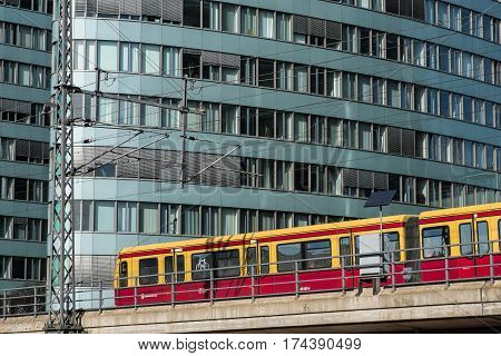 Berlin Germany - march 03 2017: S-Bahn train in front of BVG office building. BVG is the main public transport company in Berlin Germany.