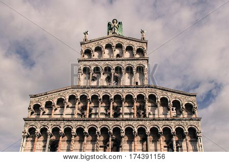 Italy Lucca - September 18 2016: the view of the fragment of San Michele in Foro facade medieval church on September 18 2016 in Lucca Tuscany Italy.