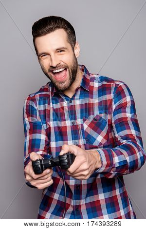 A Portrait Of  Adult Man Holding Joystick And Playing Videogames