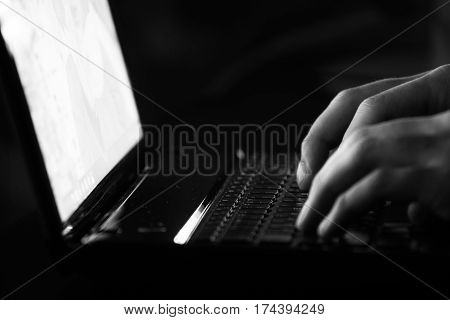 Russian hacker hacking the server in the dark Black and white