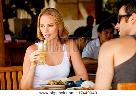 A young couple enjoying lunch at a restaurant