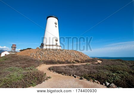 Lighthouse and winding pathway at Piedras Blancas point on the Central California Coast north of San Simeon California USA