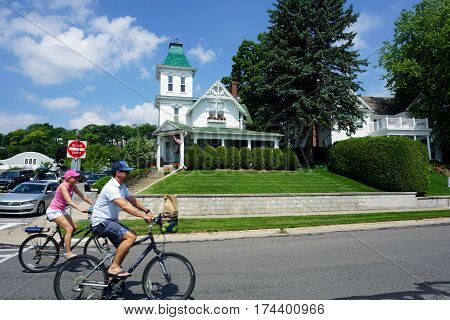 HARBOR SPRINGS, MICHIGAN / UNITED STATES - AUGUST 4, 2016: A Victorian style home with a tower stands at the corner of Gardner and Bay Streets, near the waterfront in Harbor Springs, Michigan.