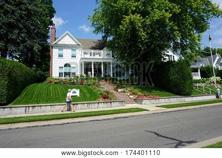 HARBOR SPRINGS, MICHIGAN / UNITED STATES - AUGUST 4, 2016: A beautiful home with a balcony on Bay Street, near the waterfront in Harbor Springs, Michigan.