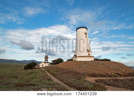 Lighthouse under cirrus cumulus cloudscape at Piedras Blancas point on the Central California Coast north of San Simeon California US of America