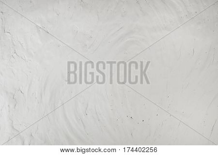 Stucco white wall background fragment or texture close-up