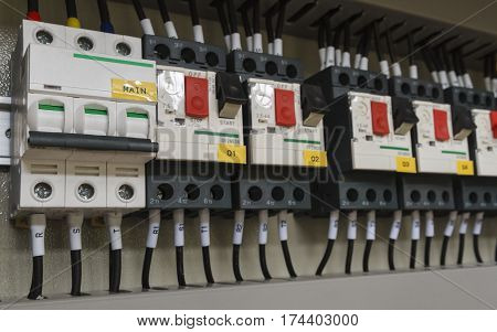 Close-up electrical wiring with fuses and contactors of machine controller.