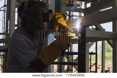 Welders were welding steel structural by arc welding - Shield metal arc, At steel structure manufacturing industry.