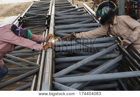 Worker without safety protective welding steel structure in construction factory, Use the wrong kind equipment and conditions hazardous working.