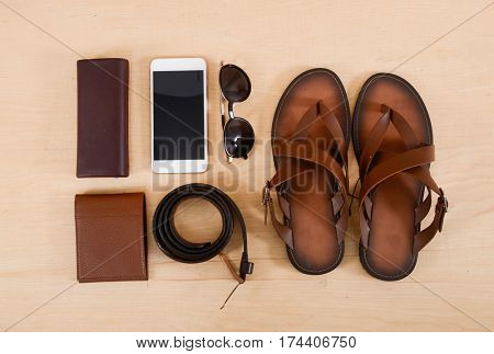 Men's casual outfits with male accessories on wooden background,