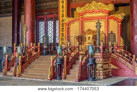Beijing, China - Oct 30, 2016: Closer glimpse of the emperor's throne in the Hall of Preserved Harmony (Baohedian). Forbidden City (Gu Gong, Palace Museum). Low light view; no flash allowed.