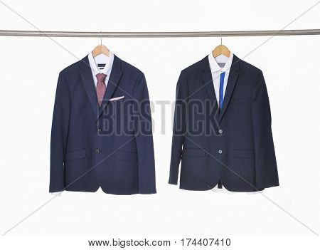 Set of two men's suits ,shirt with ties on hanging