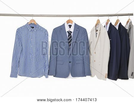 Row of men's suits hanging