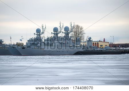 ST. PETERSBURG, RUSSIA - JANUARY 25, 2017: Two anti-submarine corvettes of the Baltic Military fleet on the winter parking in January twilight. Kronstadt