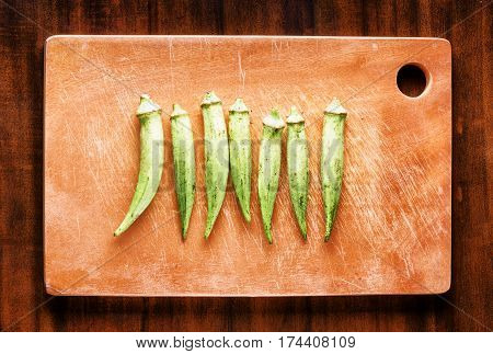 Fresh Green Seed Pods Okra On A Wooden Board. Healthy Eco Food