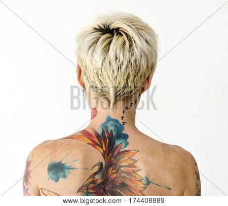 Woman bare chest topless in rear view studio portrait