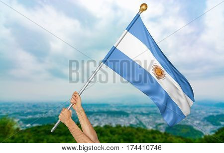 Young man's hands proudly waving the Argentina national flag in the sky, part 3D rendering