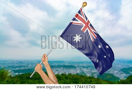 Young man's hands proudly waving the Australia national flag in the sky, part 3D rendering