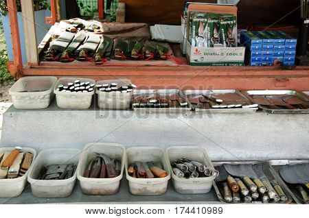 Asian Thai People Sale Many Kind Of Aranyik Knives On Wooden Shelf For Travelers People At Store Kni