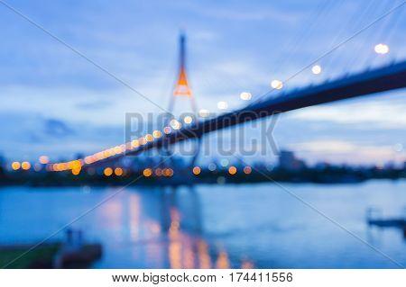 Defocused suspension bridge cross over river night view abstract background