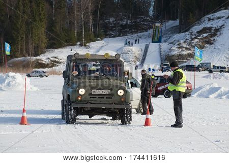 SORTAVALA, RUSSIA - FEBRUARY 18, 2017: UAZ-469 comes for start. The open championship on sports tourism of the Republic of Karelia