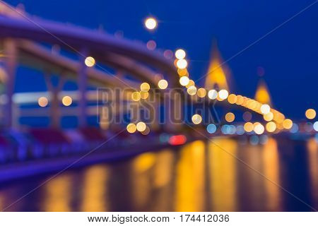 Twilight blur bokeh light suspension bridge with clear blue sky abstract background