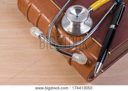 Close Up Of Stethoscope Book And Pen On Calendar, Doctor Appointment. Booking Reminder Plan For Heal