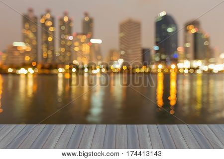 Opening wooden floor night blurred light office building water front abstract background