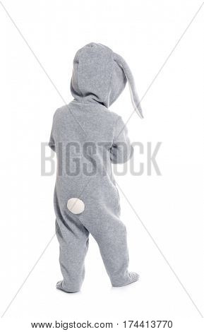 Cute little baby in bunny costume on white background