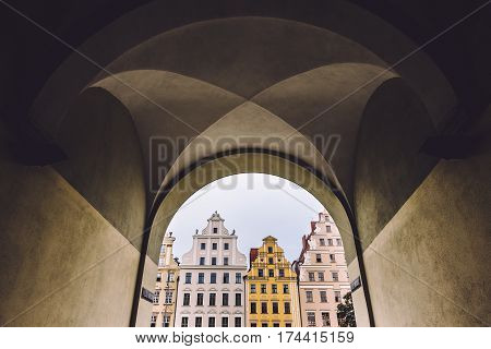 Merchant historical house facades at Wroclaw Market Square, view threw the archway. Historical capital of Silesia, Poland, Europe.