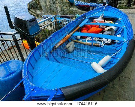 The blu fish boat at Riomaggiore, Cinque Terre National Park, Liguria, La Spezia Italy