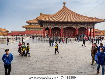 Beijing, China - Oct 30, 2016: Visitors around the Hall of Central Harmony (Zhonghedian, front). Behind is the Hall of Supreme Harmony (Taihedian). Forbidden City (Gu Gong, Palace Museum).