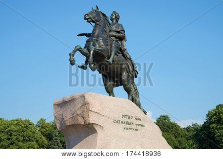 The old monument to Peter the Great (bronze horseman) closeup on blue sky background. Saint Petersburg, Russia