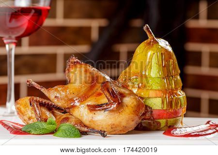 Pear with honey. Tasty dessert with honey and pear on wooden table. Pear with honey and cinnamon on a dark background with bricks. Pears and honey dripping isolated.