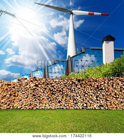 Renewable energies sources - Wind energy (wind turbine) solar energy (roofs of houses with solar panels) biomass (firewood logs) and a power line