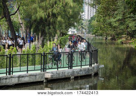 Wachira Benchathat Park, Chatuchak, Bangkok, Thailand - FEB 26: Group of asian young cyclists on cycle ride lane through public park of Wachira Benchathat Park (Rot Fai Park) on FEB 26, 2017