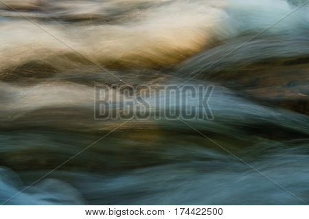 Flowing water shot at extreme close up and long shutter speed with an natural density filter for artistic effect