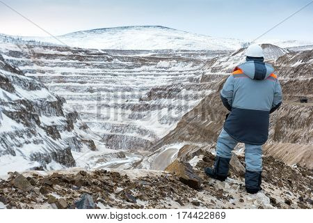 Worker at an open pit. Gold mining.
