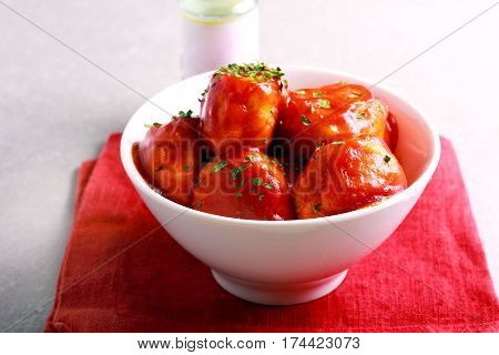 Chicken meatballs in tomato sauce in a bowl
