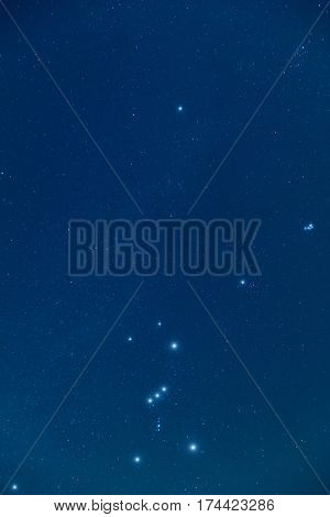 Milky way stars Orion and Pleiades on a night sky.