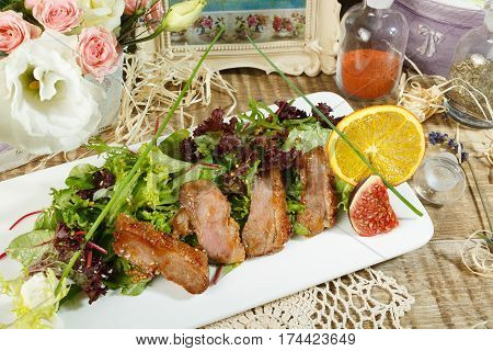 Caesar Salad. Delicious salad with croutons, grilled chicken breast, grated parmesan cheese and cos lettuce, with sauce in the gravy boat, simply and healthy recipe, horizontal top view.