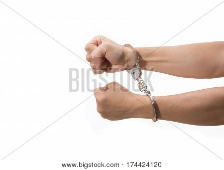 two hands with tight fists on handcuff reaching out on white background room for copyspace