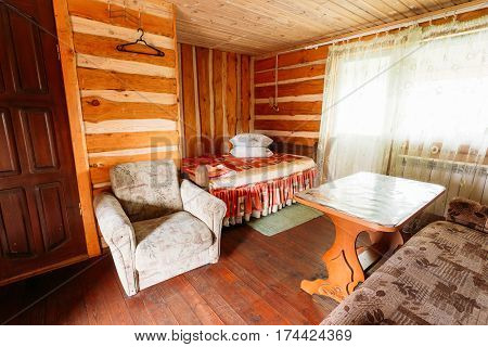 Interior Of Restroom In Belarusian Or Russian Wooden Guest House In Village Or Countryside Of Belarus Or Russia. Ecotourism And Travel.