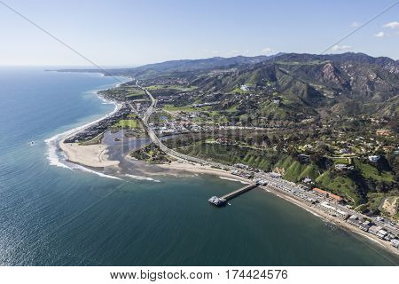 Aerial view of Malibu Pier, Surfrider Beach and the Santa Monica Mountains in Southern California.