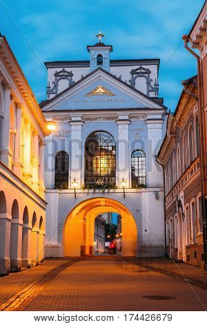 Vilnius, Lithuania. The Gate Of Dawn In Evening Illumination. The Religious, Historical And Cultural Monument, The Chapel With Miraculous Image Of Our Lady Of Mercy In Summer Twilight.