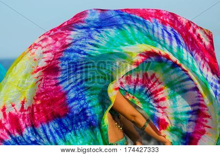 Close up of belly dance silk shawl. Colorful scarf in movement. Belly dancing detail background.
