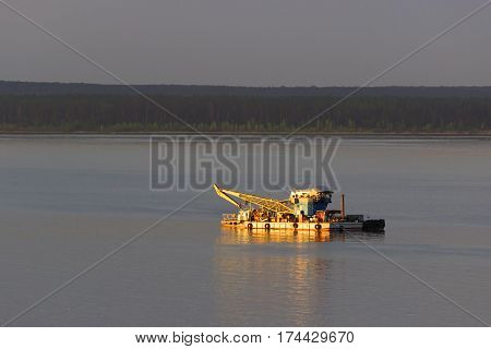 yellow industrial ship on a water. sunny