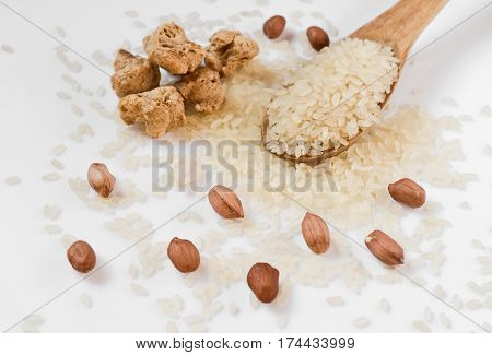 soy meat and a wooden spoon with rice and peanuts diet food abstract